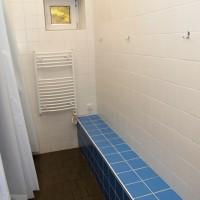 Sprchy a odkládací prostory (chlapci)